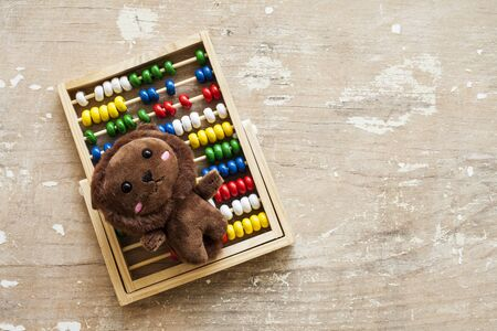 Abacus with teddy toy abacus background. Top view, Stock fotó