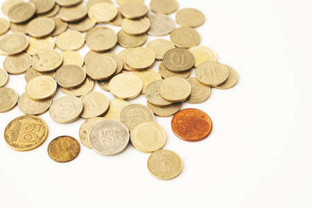 Mixed coin stacks on a white background