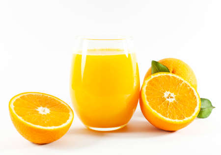 Glass of fresh orange juice with fruits cut in half and sliced with green leaf isolated on white background, clipping path