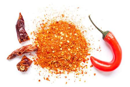 Chili, red pepper flakes and chili powder burst Stock fotó
