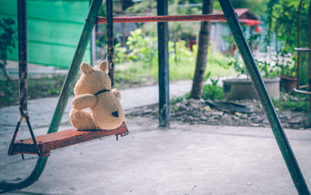 The brown dog doll playing is in the playground alone no kids. Reklamní fotografie