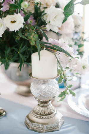 Silver candlestick as element of festive table wedding centerpieces decorations. Stock Photo