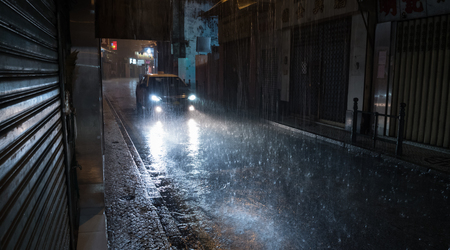 Taxi at night rainy street. the car traveling on the road and shines a blinding light. Banque d'images