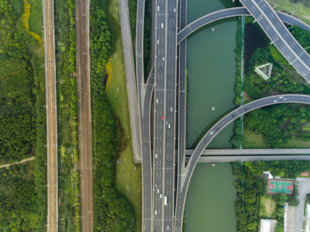 Aerial drone flight over evening road traffic. Two-level road junction. Banque d'images