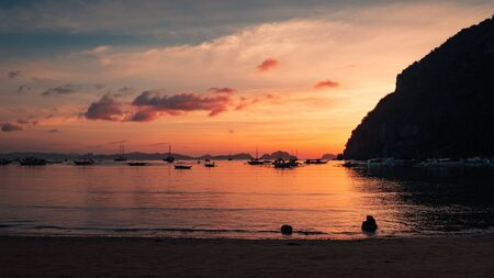 Beautiful sunset with silhouettes of philippine boats in El Nido, Palawan island, Philippines