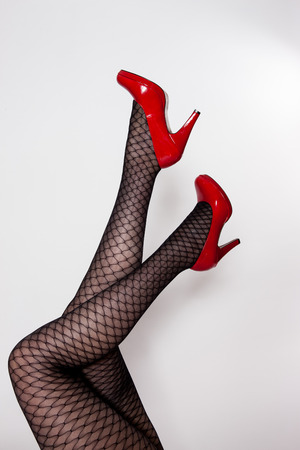 red shoes: Legs with red shoes