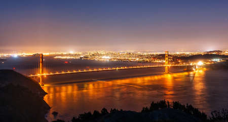 The Golden Gate bridge and San Francisco at night