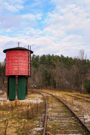 the red water tower and the rail in the country Фото со стока