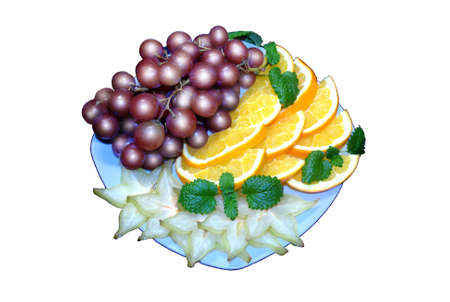 plate with apfelsine and grapes