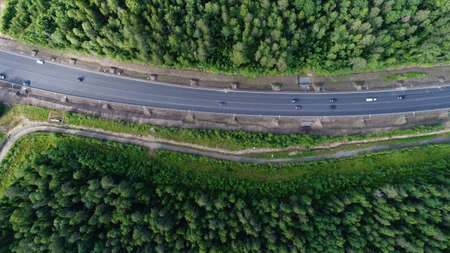 Aerial shot of beauty forest nature landscape with road. Zdjęcie Seryjne