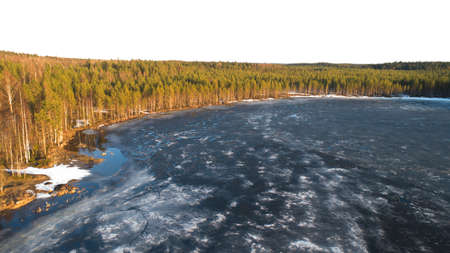 Drone view on river with melting ice, sunny spring weather. Imagens