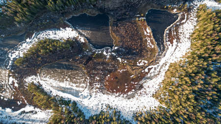 Drone view on wild nature rural forest with lake and snow melting in spring Stockfoto - 122949295