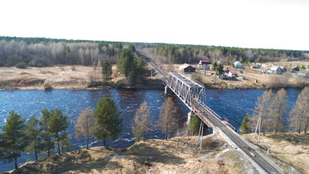 Drone view on the rail bridge across the river in rural place in spring Zdjęcie Seryjne