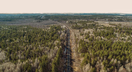 Aerial drone view of an railroad across the spring forest. Rural places Zdjęcie Seryjne