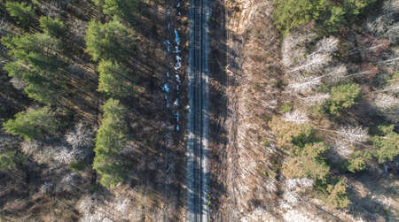 High aerial drone view of an railroad across the spring forest. Rural places Zdjęcie Seryjne