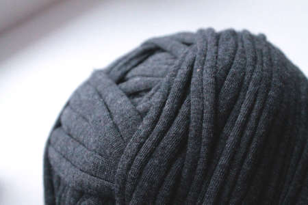 Clew of dark thread for knitting close up