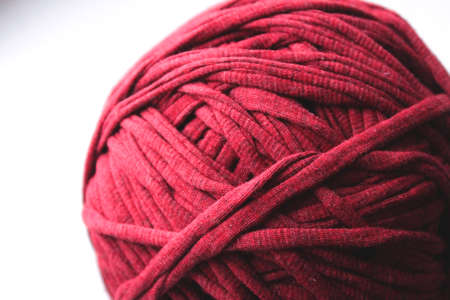 Close up view of red clew thread for knitting on white background Zdjęcie Seryjne