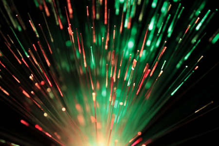 Bundle of optic fibers in red and green lights