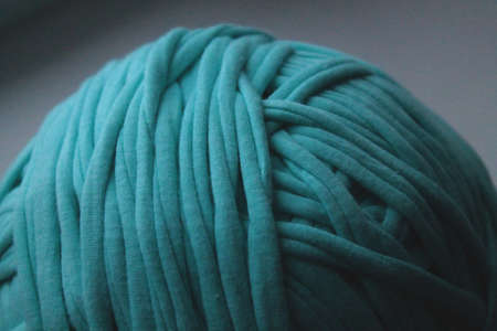 Close-up view of green clew thread for knitting