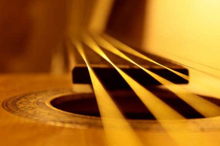 Acoustic guitar strings closeup, warm colors