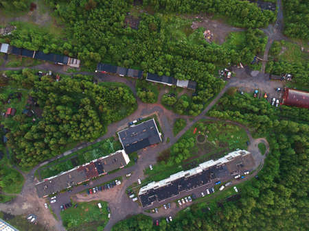 Aerial view of houses roofs in the forest
