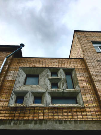 View of a set of square windows. Old Soviet building.
