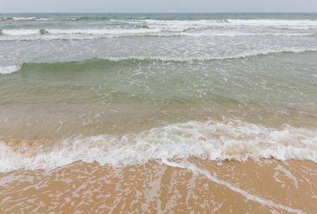 strom: strom beach strong wave windy day