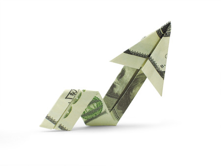 origami arrow of hundred dollar banknotes Stock Photo