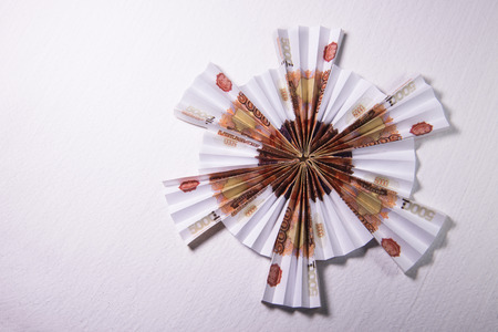 rubles: snowflake origami made of banknotes rubles. Handmade