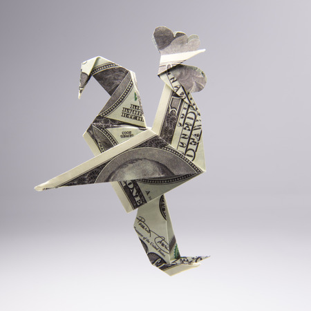 Origami Out Of Money In The Form Of A Cock Stock Photo Picture And