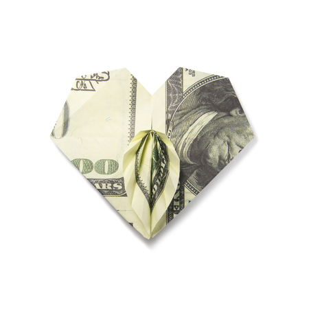 origami heart of banknotes on a white background