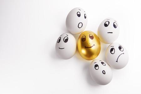 white and one Golden egg
