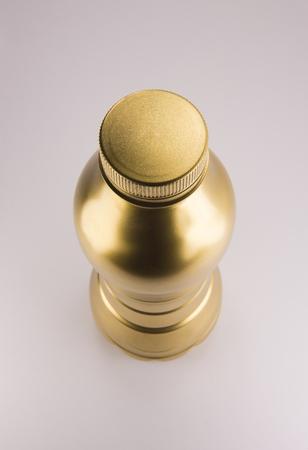 Gold plastic bottle