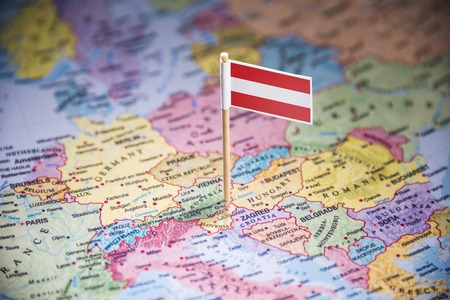 Austria marked with a flag on the map