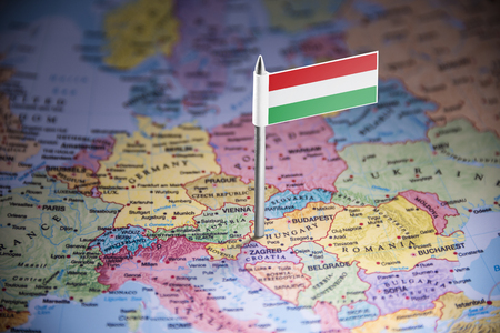 Hungary marked with a flag on the map