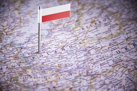 Poland marked with a flag on the map Editorial