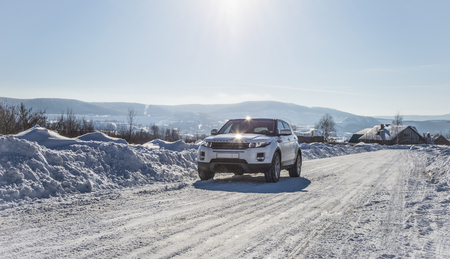 White Range Rover Evoque with a black roof on a winter road on the background of Zhiguli mountains of Samara region, Russia. Clear Sunny day 9 February 2019 Editorial