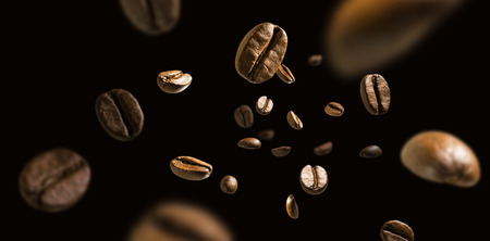 Coffee beans in flight on a dark background