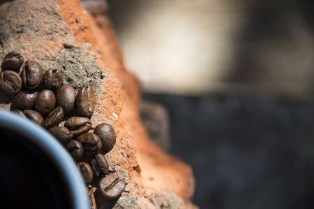 Cup of coffee and coffee beans on a stone background. Reklamní fotografie
