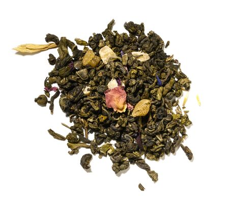 Green tea with aromatic additives. Top view on white background