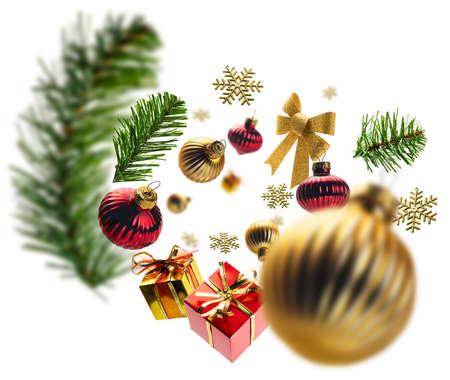 Christmas decorations and gifts levitate on a white background. Foto de archivo