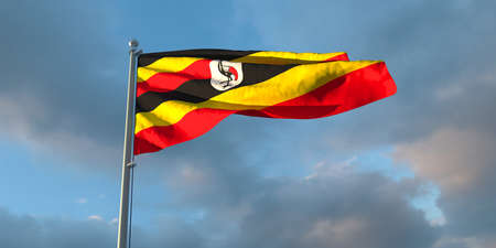 3d rendering of the national flag of the Uganda in the evening at sunset against a background of beautiful clouds