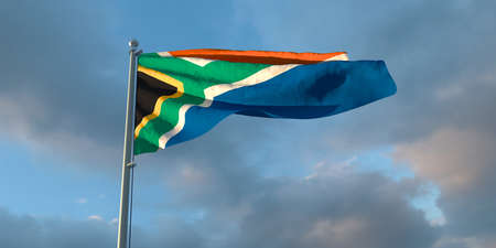 3d rendering of the national flag of the South Africa in the evening at sunset against a background of beautiful clouds