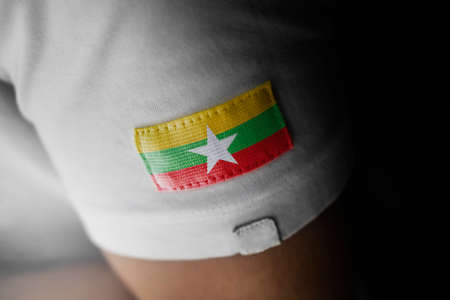Patch of the national flag of the Myanmar on a white t-shirt