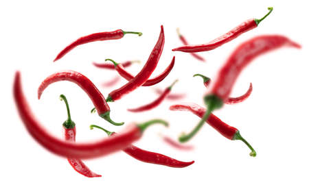 Red hot pepper levitates on a white background