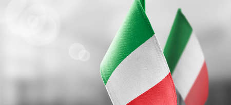 Small national flags of the Italy on a light blurry background Standard-Bild