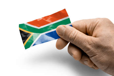 Hand holding a card with a national flag the South Africa