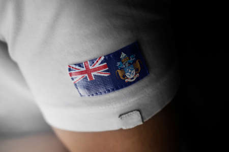 Patch of the national flag of the Tristan da Cunha on a white t-shirt