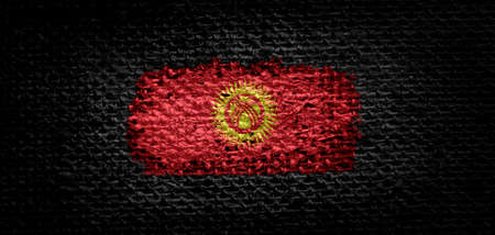 National flag of the Kirghizia on dark fabric