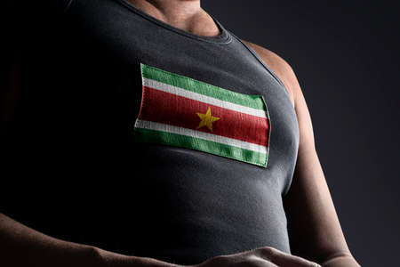 The national flag of Suriname on the athletes chest